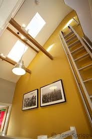 innovative use of pull out ladder to access mezzanine style loft