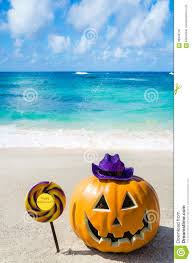 halloween pumpkin background on the beach stock photo image