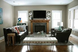 living room furniture placement in with fireplace and pictures