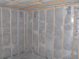 blown cellulose insulation completely fills netted wall and