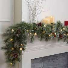 cordless pre lit led snowfrosted garland at brookstone