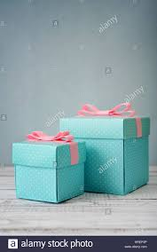 polka dot gift boxes blue polka dots gift boxes with pink ribbons on wooden background