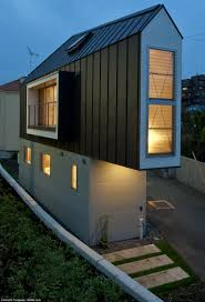 Living Big In A Tiny House by This Triangular House In Suginami Tokyo Is No Wider Than Car