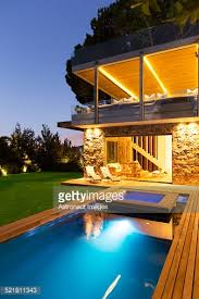 Pool At Night Modern House Overlooking Illuminated Swimming Pool At Night Stock