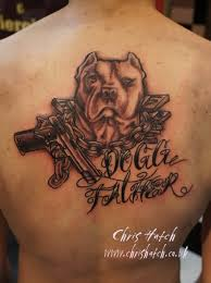 gangster dog with gun tattoo on man upper back