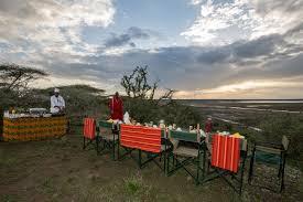 table in the wilderness bush lunch lake ndutu luxury tented lodge tns hospitality lake