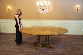 large 64 84 round solid oak dining table with leaves fully opened this solid oak table with self storing leaves seats 8