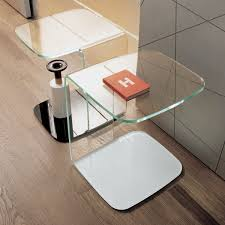 shell curved glass table coloured base klarity glass furniture