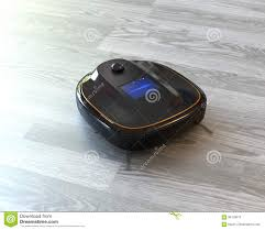 black robotic vacuum cleaner on laminate flooring stock