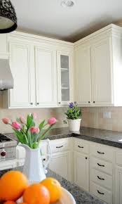 how to make cabinets appear taller adding height to your kitchen cabinets
