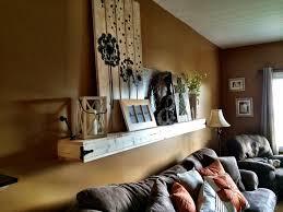 floating shelf above couch living room pinterest shelves