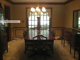 dining room dark wood duncan phyfe dining table with chandelier