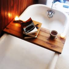 bathroom 2017 wooden bath caddy with books and a cup of coffe bathroom 2017 wooden bath caddy with books and a cup of coffe also white unique bathtubs with stainless mixer taps as well as wooden wall panels inspiring