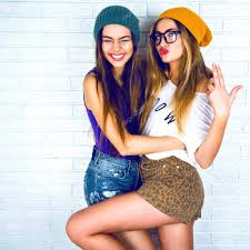 hipster girl hipster girls posing at wall background stock photo