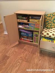 board game storage cabinet how to use a wide hallway for game storage life creatively organized