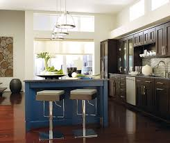 kitchen with brown cabinets wood cabinets with a blue kitchen island omega