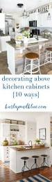 Decor For Top Of Kitchen Cabinets Best 25 Above Cabinet Decor Ideas On Pinterest Above Kitchen