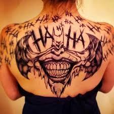 tattoo back face joker face in bat tattoo on girl upper back