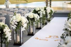white aisle runner ceremony décor photos lantern décor along aisle runner inside