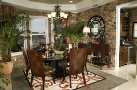 tropical dining room with chandelier by tonia mathis fils aime