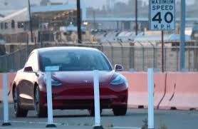 tesla model 3 7th production car spotted rear seat photos