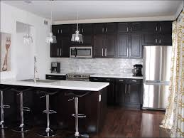kitchen black and white kitchen floor light brown cabinets