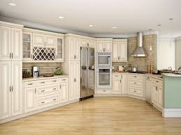 White Kitchen Cabinets With Black Appliances by Cream Color Kitchen Cabinets Image Of Natural Brown Wooden