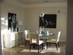 Small Round Dining Room Table Black Leather Padded Seats Area Black Stained Cement Floor Small
