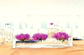 modern centerpieces wedding centerpieces hot pink purple flowers clear trough