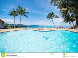 beautiful swimming pool overlooking the sea stock photo image