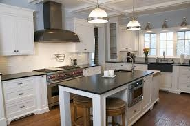 white kitchen cabinets with slate countertops slate countertop christopher developments kitchen