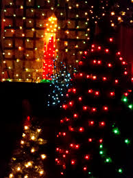 christmas lights candle and trees picture free photograph