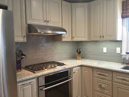 modren white subway tile backsplash cabinets and red oak flooring