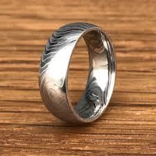 steel titanium rings images Tiger stripe damascus steel wedding ring titanium buzz jpg