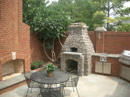 patio with outdoor kitchen fireplaces creative fireplaces design