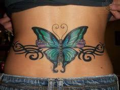 lower back with tribal and butterfly picture at