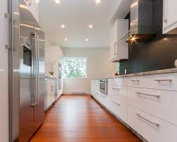 galley kitchen design features high end white cabinet with long