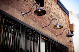 Barn Light Originals by Xtra Shiny Serves Up A Liquor Bar With Industrial Style Barn