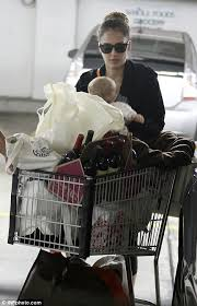 alba slips into sporty during grocery shop to