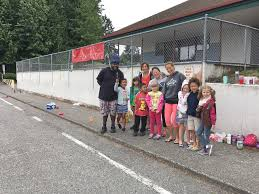 leapin leopards it s a jungle out there at lowell elementary artist and parent nico gomez is shown with some of the girl scouts who cleaned and scraped the wall so he could paint the mural at lowell elementary school