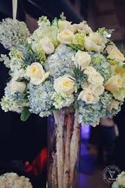 White Roses Centerpieces by Pilsner Vase With White Hydrangea Eucalyptus Dusty Miller