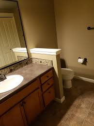 what color goes with brown bathroom cabinets what color should i paint my sad brown bathroom