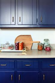 glidden rich navy covers the newly painted cabinetry antique kitchen cabinets glidden rich navy covers the newly painted cabinetry antique brass hardware finishes look