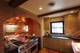 copper backsplash marble countertop slide in range and vent