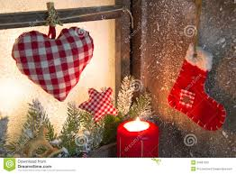handmade christmas wooden window decoration with heart and a red
