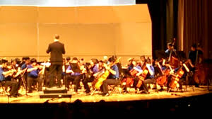vedic the violinist playing with fulton county youth orchestra