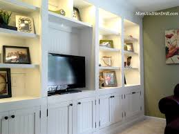 cool black and brown painted finish living room wall unit stylish