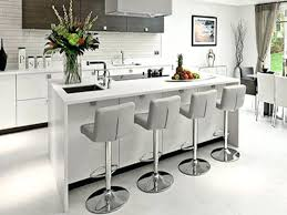 stools add color to a white kitchen and dining space with bright