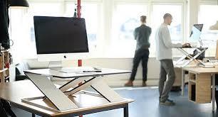 Benefits Of Standing Desk by 5 Benefits Of A Standing Desk Awaken