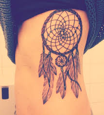 with dreamcatcher on rib cage
